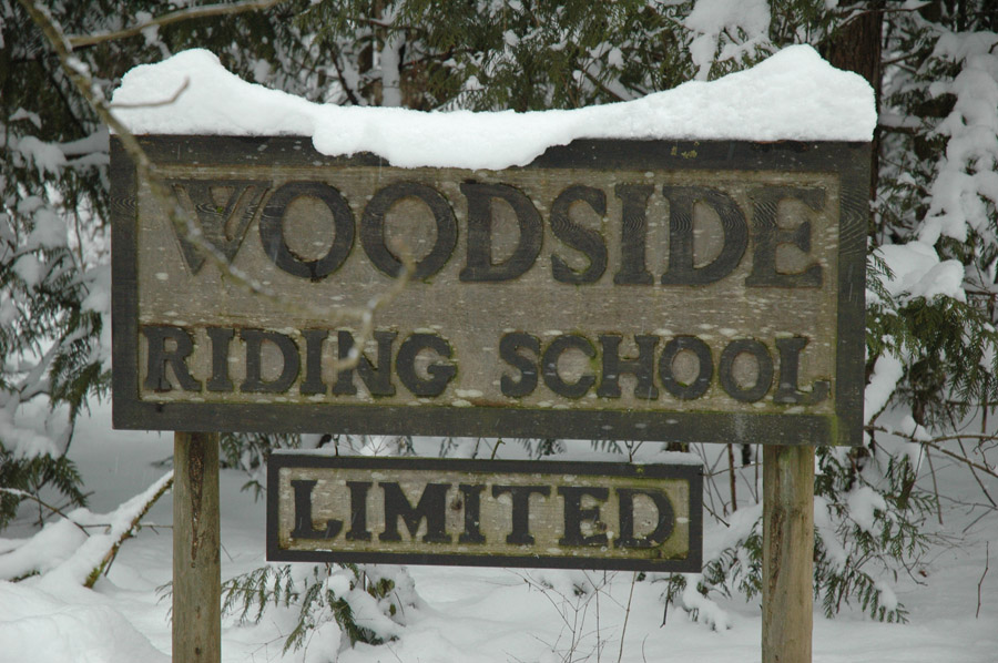 Woodside sign in snow